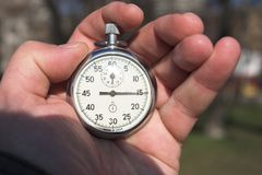 Chronometer. A chronometer in the hand Stock Photo