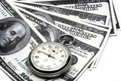 Chronometer and dollar bills Stock Image