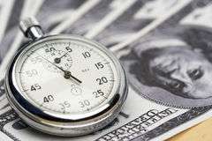 Chronometer and dollar bills Royalty Free Stock Photography