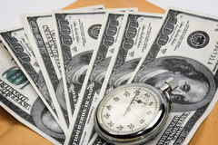 Chronometer and dollar bills Royalty Free Stock Images