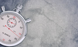 Chronometer op grijs Stock Foto's