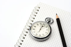 Chronometer and  pen. Chronometer and black  pen over notebook Royalty Free Stock Photography