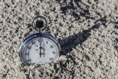 Chronometer in Sand Royalty Free Stock Photography