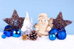 Chrsitmas decoration. Christmas decoration - santa claus and snowman on snow Royalty Free Stock Images