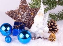 Chrsitmas decoration - blue. Santa claus figure with presents and xmas balls with xmas tree Royalty Free Stock Image