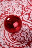 Chrsitmas red ball over indian pattern. Background Stock Image