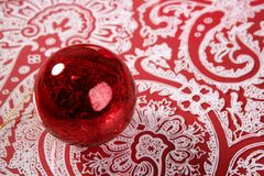 Chrsitmas red ball over indian pattern. Background Royalty Free Stock Photography