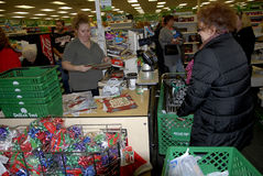 CHRSTMAS SHOPPERS AT DOLLAR TREE STORE Stock Photography