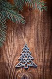 Chrstmas toys fir tree with branches of firtree  on old wooden b Royalty Free Stock Photos