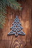 Chrstmas toys fir tree with branches of firtree  on old wooden b Stock Photo