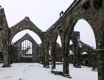 Chruch of st thomas a becket in heptonstall in falling snow royalty free stock images