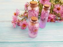 Chrysanthemum flower extract on wooden background stock photography