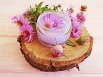 Chrysanthemum flower freshness  treatment  aromatherapy  cream floral extract moisturizing on wooden background royalty free stock photos