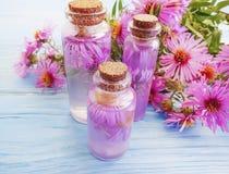 Chrysanthemum flower handmade extract moisturizing on wooden background royalty free stock photography