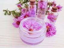Chrysanthemum flower freshness cream  handmade floral extract moisturizing on wooden background royalty free stock photography
