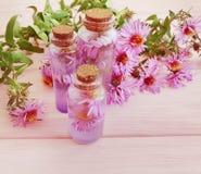 Chrysanthemum flower handmade floral extract moisturizing on wooden background stock image