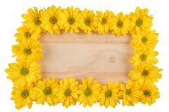 Chrysanthemum. A frame of yellow chrysanthemum on wood texture royalty free stock images