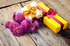 Chrysanthemum with gift box  and  bows  on wooden background Royalty Free Stock Image