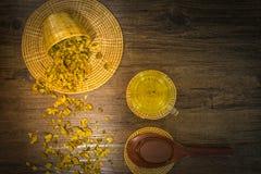 Chrysanthemum tea and honey bee on wood background Stock Photo