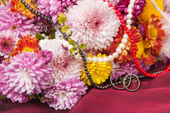 Chrysanthemum  and wedding rings Royalty Free Stock Images