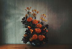 Chrysanthemums, Calla Lily's and Kangaroo Foot Flowers. Arranged together with Cotinus Coggygria and Harlequin pumpkins. Subtle Halloween decorations are Stock Photo