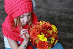 Chrysanthemums flowers in girl hands. Beautiful little girl with a bunch of flowers Royalty Free Stock Photos