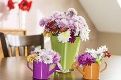 Chrysanthemums flowers in green glass vase Royalty Free Stock Photos