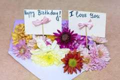 Chrysanthemums flowers in purple envelope with i love you card Royalty Free Stock Image