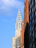 Chrysler building. Picture of the chrysler building taken in the street with other buildings Stock Photos