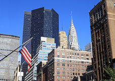 The Chrysler building in New York City. A view of New York city with the american flag Royalty Free Stock Photography