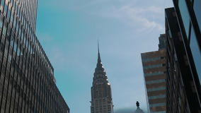 Chrysler Building New York, Low angle shot of camera rotating in front of skyscrapers. Office blocks, and Apartments stock video footage