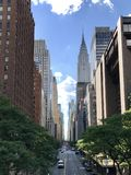 Chrysler Building from Tudor City Overpass. A view of 42nd street from above the road looking from east to west across entire island of Manhattan. Iconic art Stock Photos