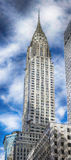 Chrysler Bulding and blue sky with white clouds. Chrysler Bulding against the background of blue sky and clouds Stock Photography