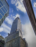 Chrysler Bulding - view from the bottom. Chrysler Bulding, among other skyscrapers against the background of blue sky and clouds Stock Photography