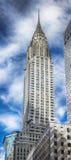 Chrysler Bulding y cielo azul con las nubes blancas Fotografía de archivo