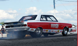 Drag racing. Napierville dragway august 23, 2014 rear side view of chrysler drag car making a burnout at john scotti all out event Royalty Free Stock Photography