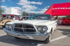 1960 Chrysler 300F at the Woodward Dream Cruise. ROYAL OAK, MI/USA - AUGUST 14, 2014: A 1960 Chrysler 300F car at the Woodward Dream Cruise, the world's largest Royalty Free Stock Image
