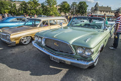 1960 Chrysler New Yorker 2 Door Convertible. Every Wednesday during the months of May to August there is a veteran car meeting with American cars at the fish Royalty Free Stock Photo