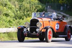 CHRYSLER 75 1929 on an old racing car in rally Mille Miglia 2018 the famous italian historical race 1927-1957. PESARO COLLE SAN BARTOLO , ITALY - MAY 17 - 2018 royalty free stock images