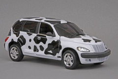 Chrysler PT Moo Cruiser. Chrysler PT Cruiser Moo Cruiser, Maisto 1:18 scale diecast miniature replica, right front view Royalty Free Stock Images