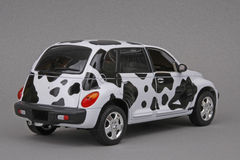 Chrysler PT Moo Cruiser. Chrysler PT Cruiser Moo Cruiser, Maisto 1:18 scale diecast miniature replica, right reAR view Royalty Free Stock Photo