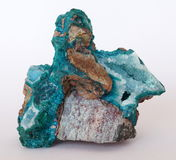 Chrysocolla with Quartz. A rock covered in Chrysocolla crystals and containing several pockets of Quartz. This specimen was found in the Ray Mine, Arizona, USA Stock Photo