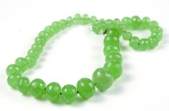 Chrysoprase beads. Beads from semiprecious stone Chrysoprase Royalty Free Stock Images