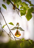 Chrystal angel figure. Chrystal decoration, figure of angel, hanging on a branch of birch tree Stock Images