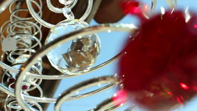 Chrystal Ball Chimes Spinning. Chrystal Ball Chimes Moving and Spinning in the wind, with silver metal circles
