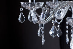 Chrystal chandelier close-up. On black background Stock Image