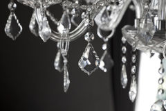 Chrystal chandelier close-up. On black background Royalty Free Stock Photo