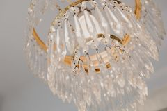 Chrystal chandelier close-up. Glamour background with copy space stock photos