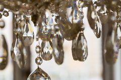 Chrystal chandelier close-up. Glamour background with copy space. Crystal chandelier, lamp in macro photography, glamour background Royalty Free Stock Image