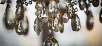 Chrystal chandelier close-up. Glamour background with copy space. Crystal chandelier, lamp in macro photography, glamour background Stock Photography